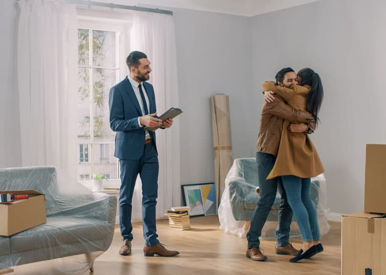 Real estate broker who's just helped a young couple find their dream home