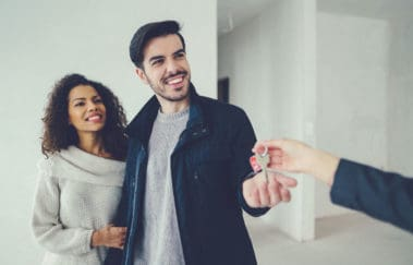 Millennial home buyers getting the keys to their new house