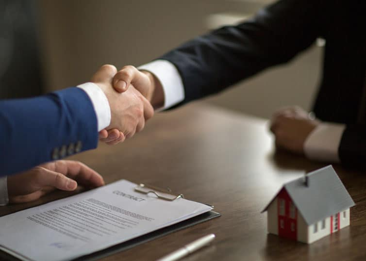 North Carolina broker using real estate negotiation strategies to close a deal
