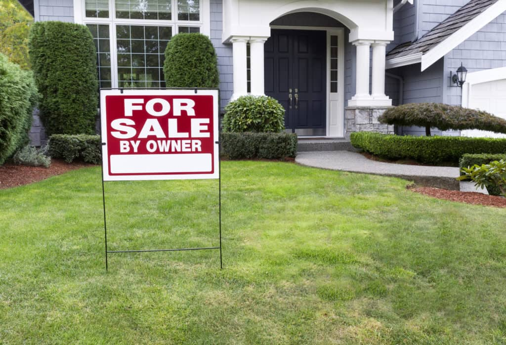 Modern Home for Sale By Owner with sign in front yard