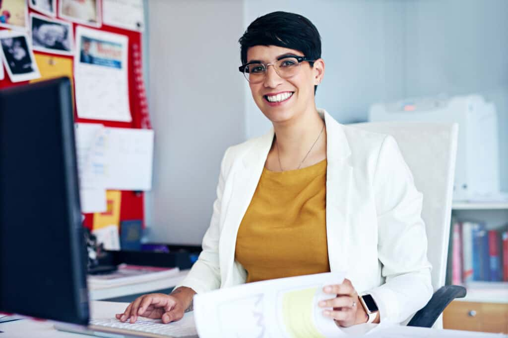 Portrait of a young businesswoman working at her desk