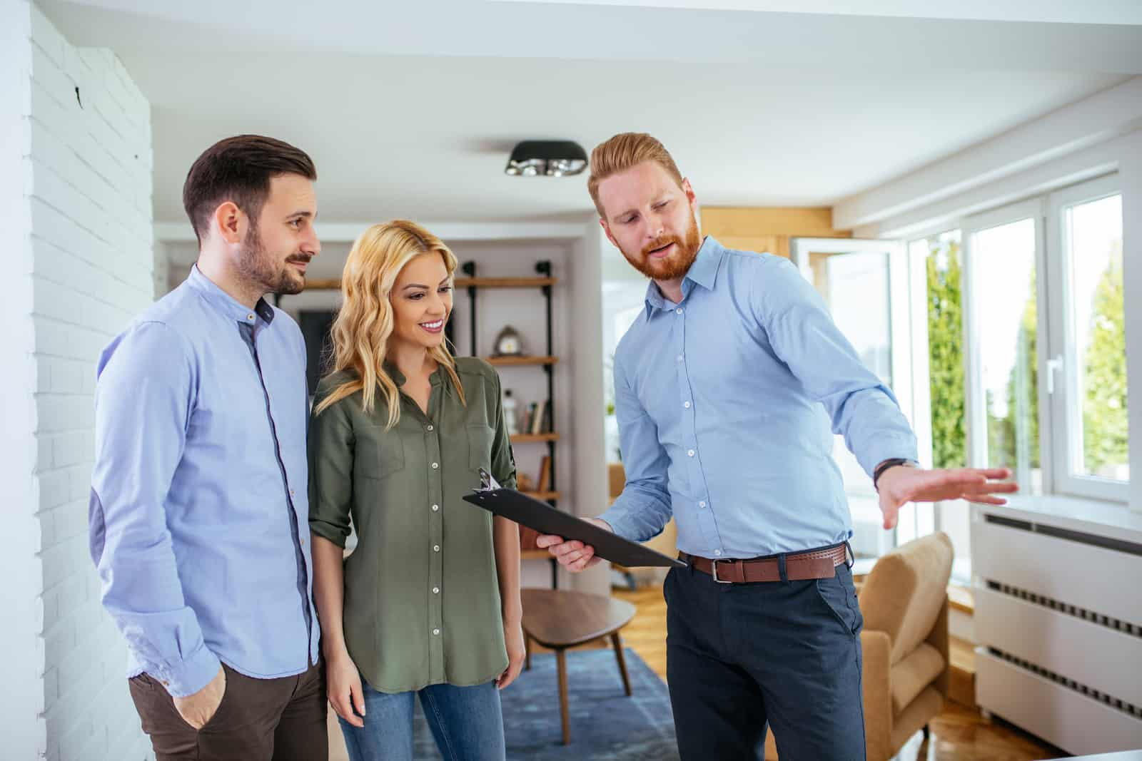 Young couple consulting with their real estate agent